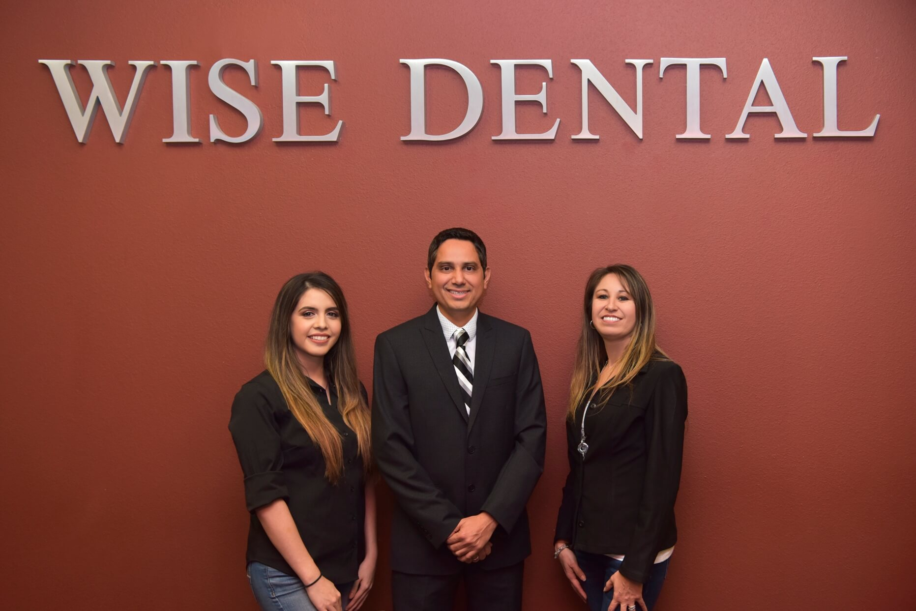 Dr. Patel (Managing Dentist) with Office Manager and Assistant Manager